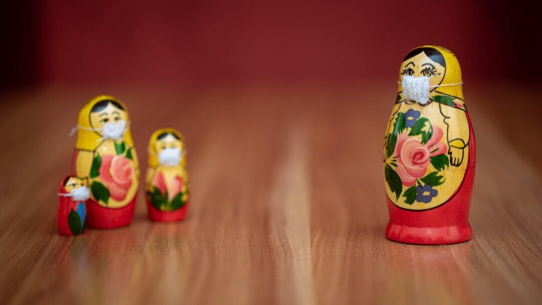 Russian dolls wearing face masks