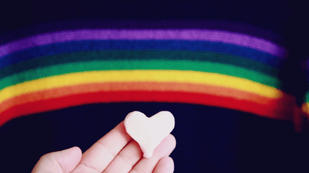 rainbow with heart in hand