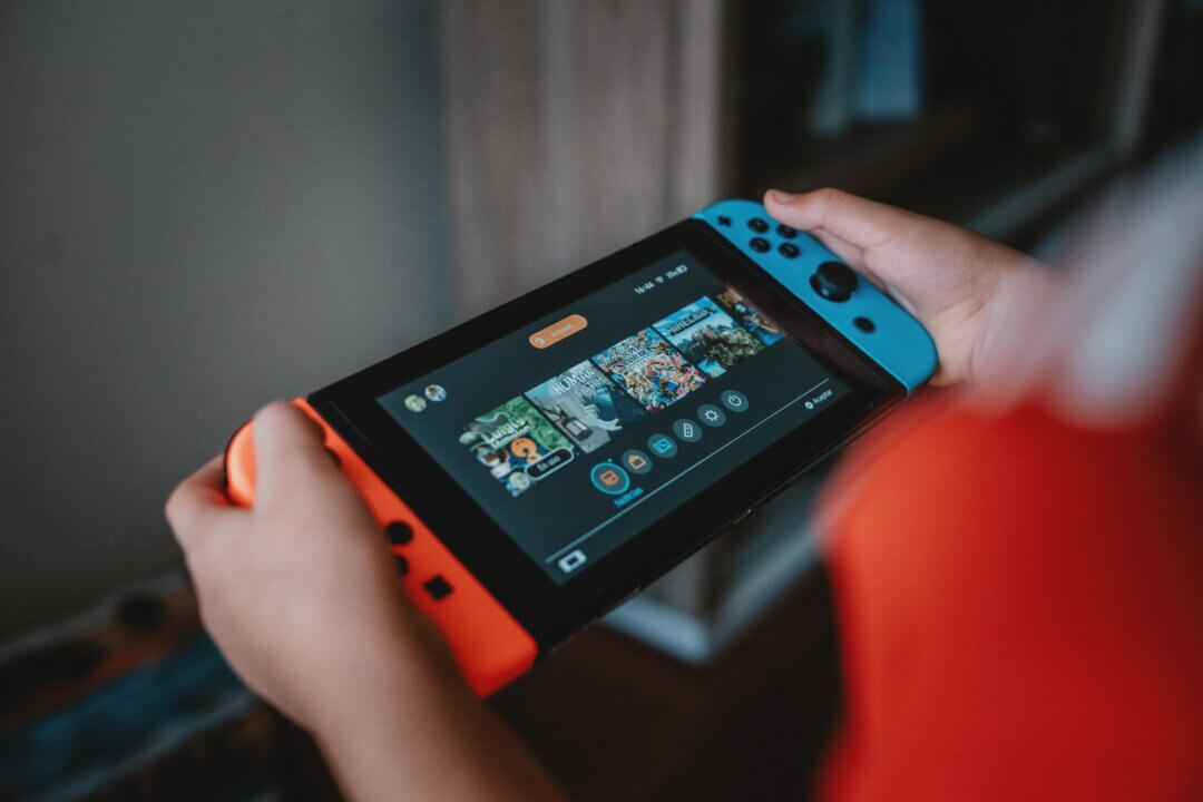 Image of someone playing on a Nintendo Switch. Therapy with young people can involve talking about their interests.