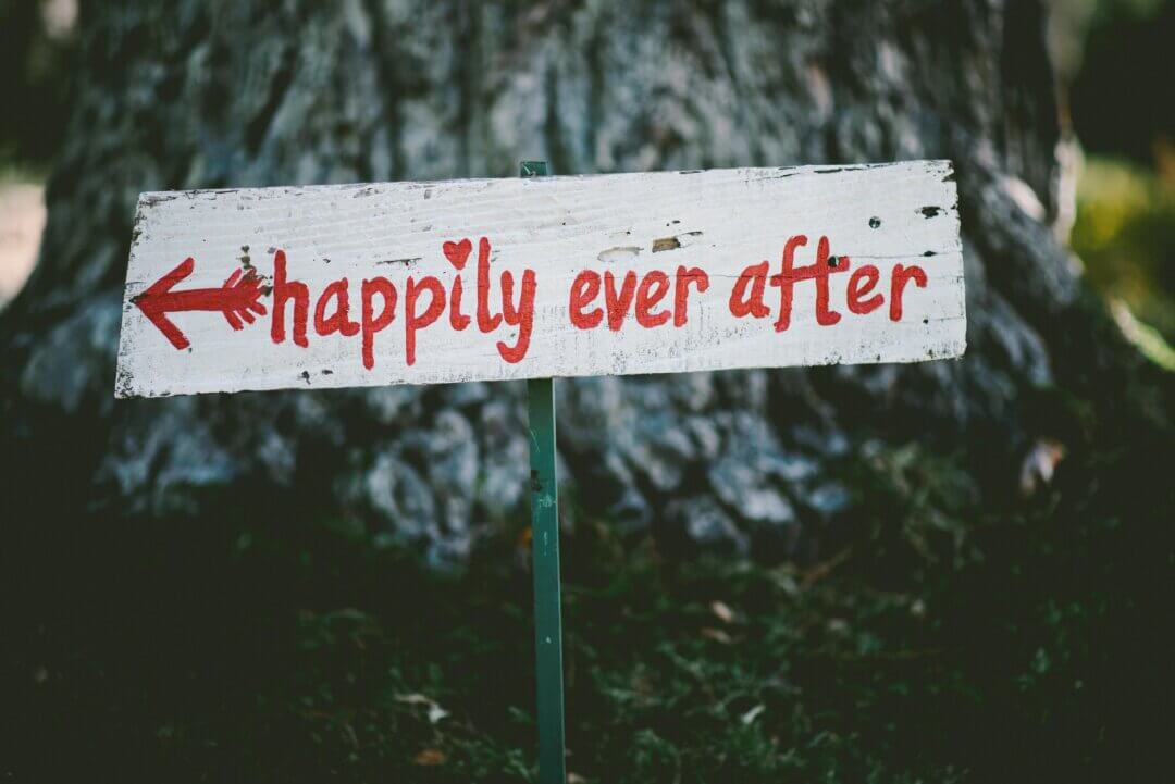 """A sign pointing left with the words """"happily ever after"""" in front of a tree. Therapists need to understand gender, sexual and relationship diversity."""